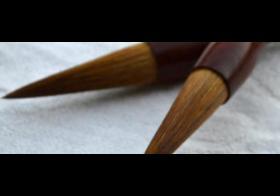 玉吊坠笔什么材质好 佩戴玉吊坠笔的注意事项有哪些?